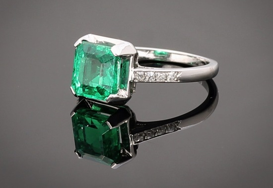 square cushion cut vintage engagement ring with emerald and diamonds