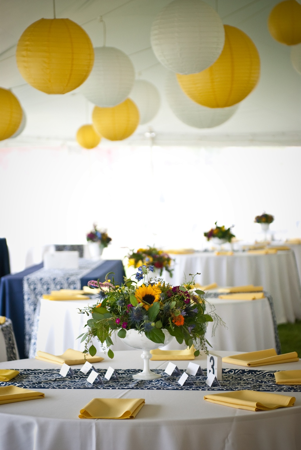Tented-wedding-reception-yellow-navy-color-palette.full
