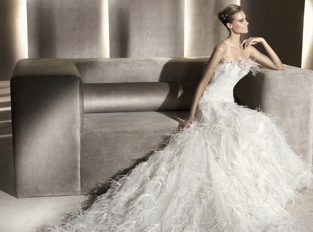 Ivory wedding dress covered with romantic feathers