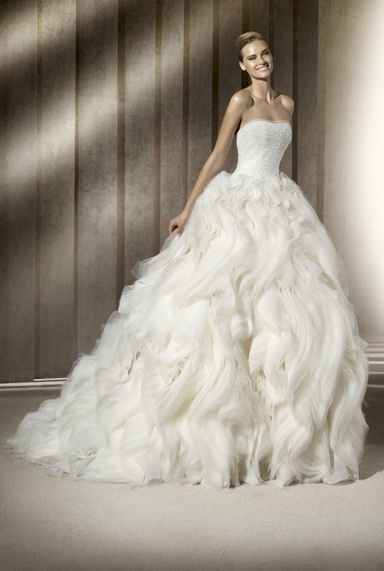 Dramatic ballgown wedding dress with layered skirt