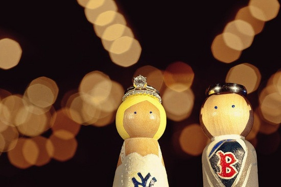 baseball lovers wedding cake topper with engagement ring