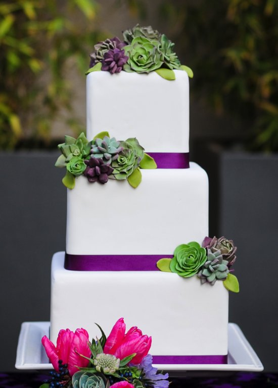 White wedding cake with pink, purple and green details