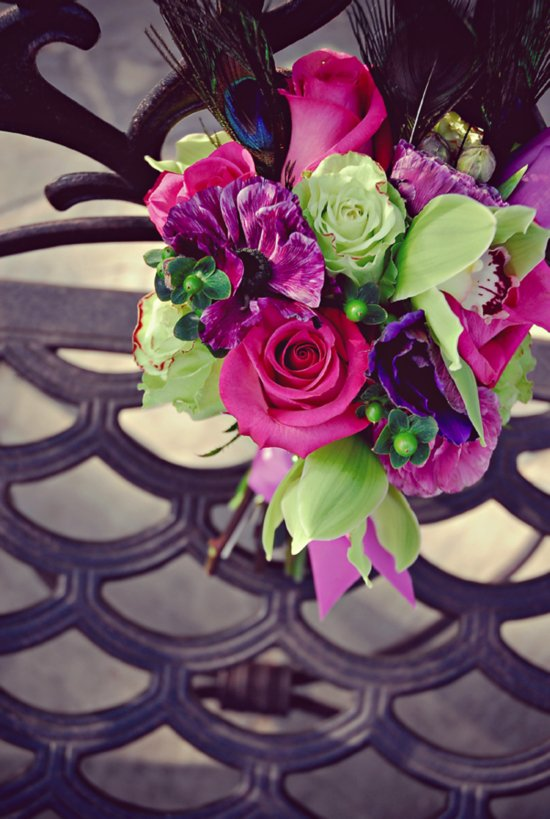 Statement bridal bouquet of pink roses, purple flowers, green orchids