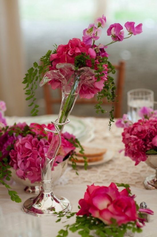 Whimsical pink and purple wedding reception centerpieces