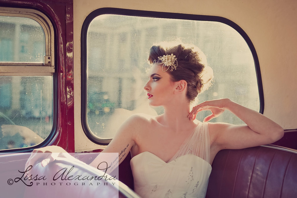 vintage glam bride wears jeweled headpiece and one shoulder gown