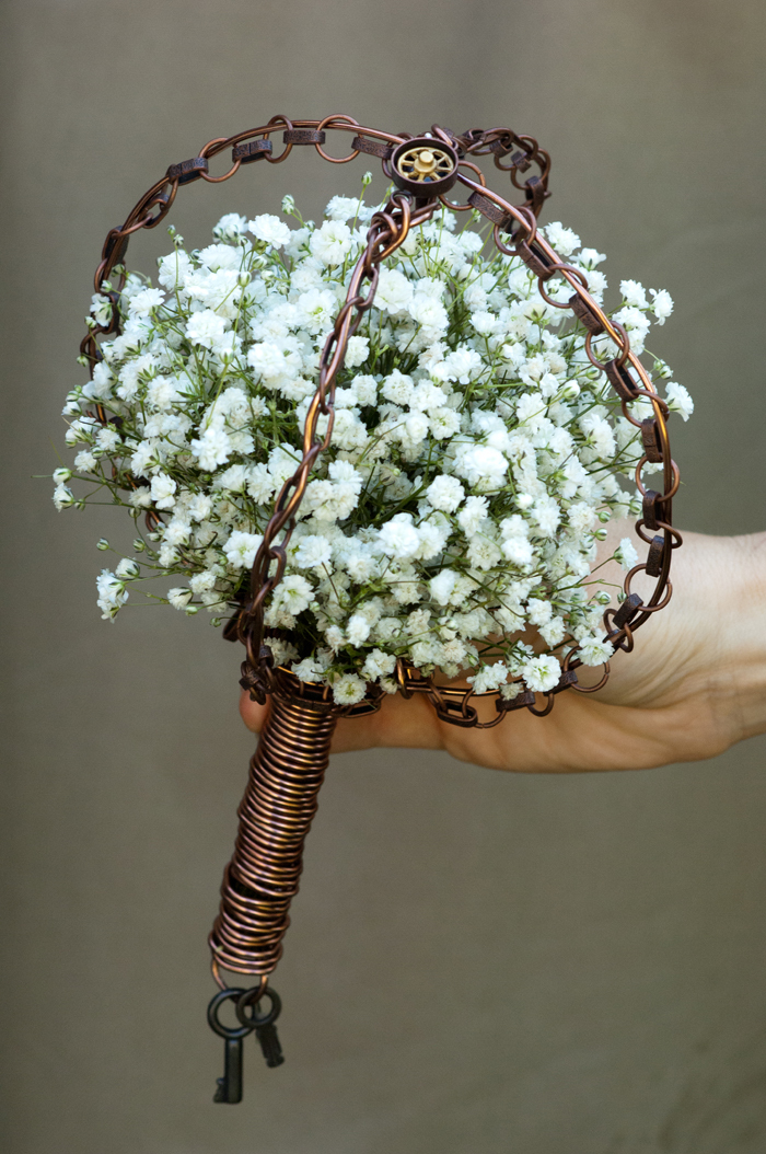 Classic white bridal bouquet with vintage edgy styling