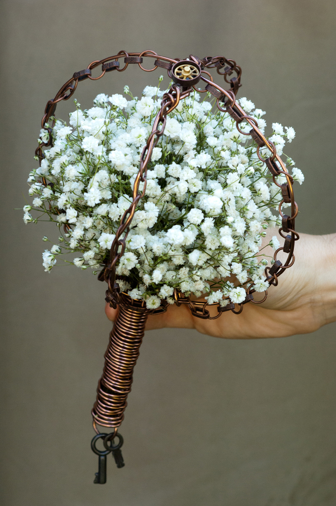 photo of Classic white bridal bouquet with vintage edgy styling