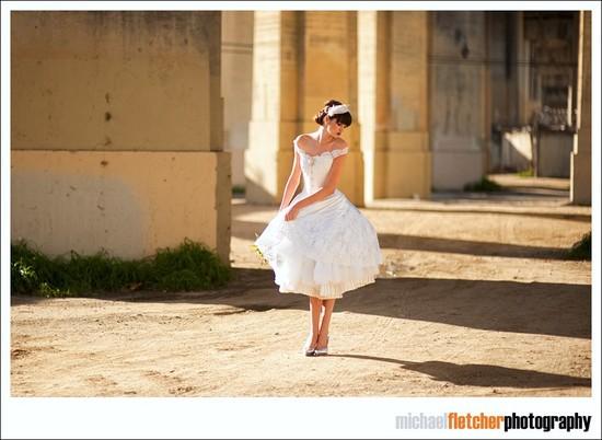 photo of tea length off the shoulder wedding dress