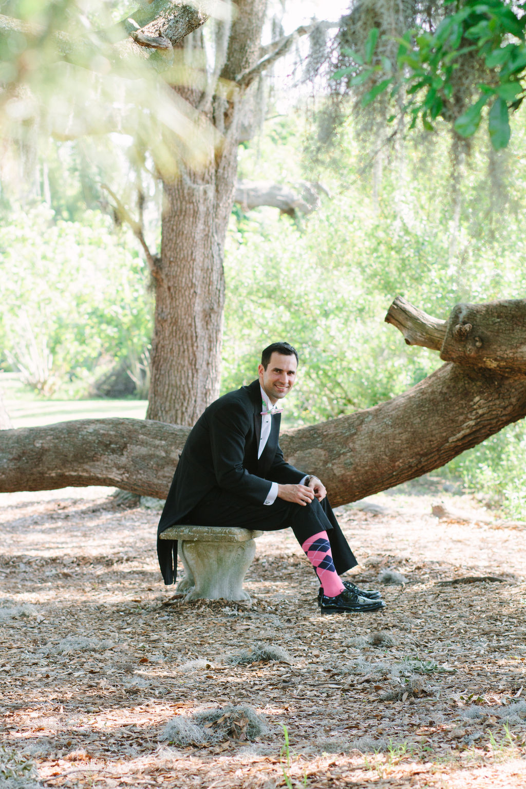 Classic groom shows off funky pink argyle socks
