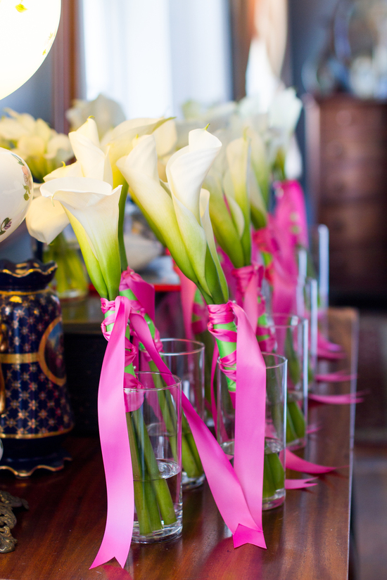 Simple ivory calla lily wedding bouquets tied with bright pink ribbons