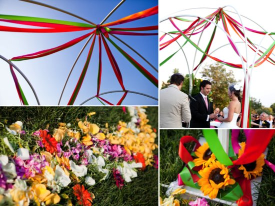 Colorful outdoor wedding ceremony with ribbon-draped Chuppah