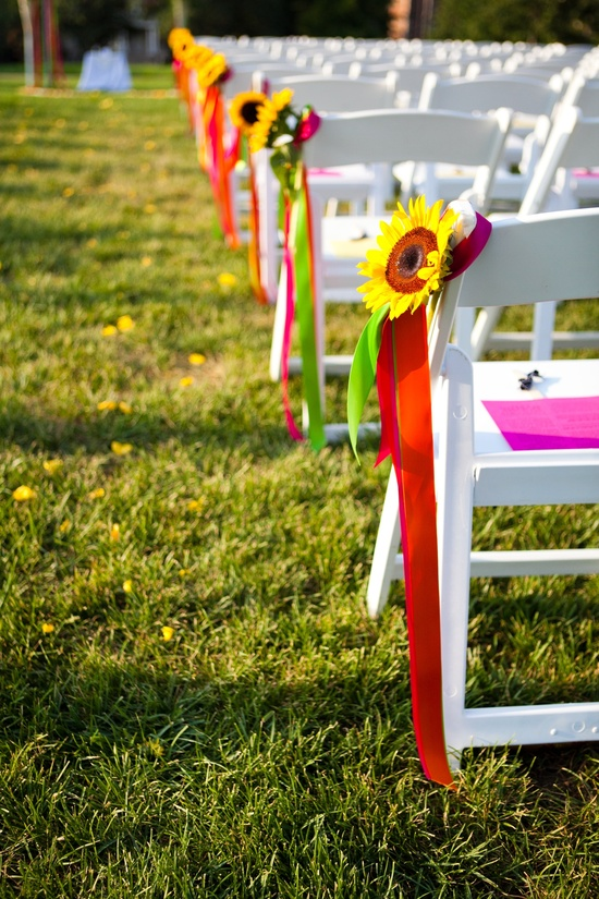 Colorful outdoor wedding ceremony with sunflower wedding flowers