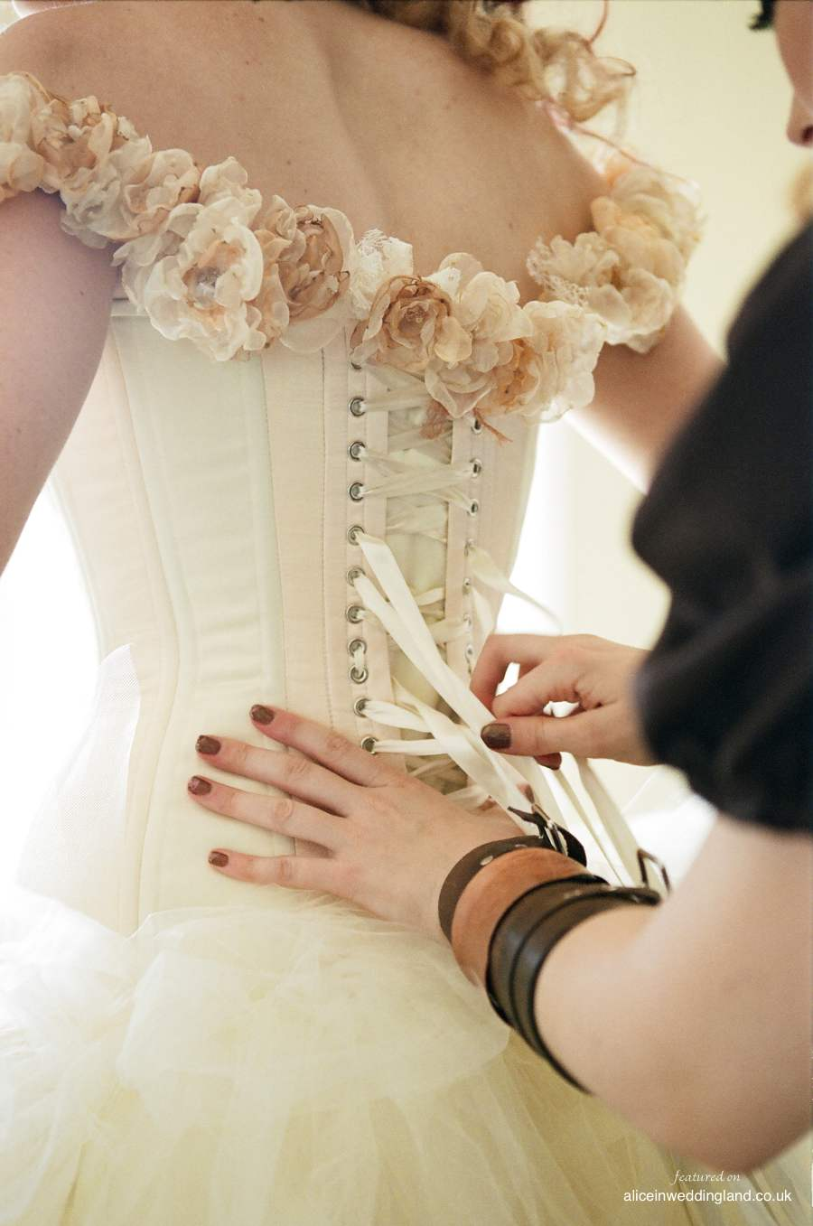 Steampunk bride wears corset wedding dress and classic for Victorian corset wedding dresses
