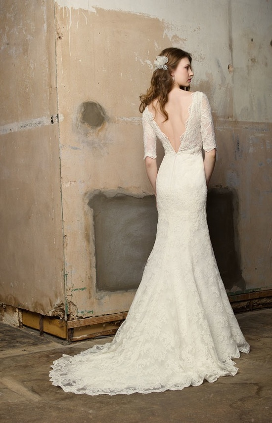 Lace sleeved wedding dress with open back