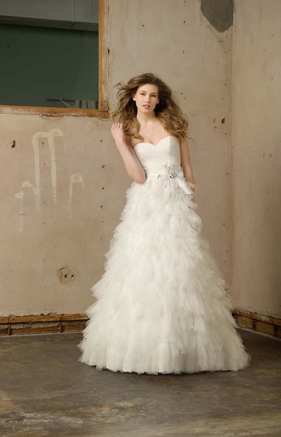 A-line wedding dress with feather-adorned skirt