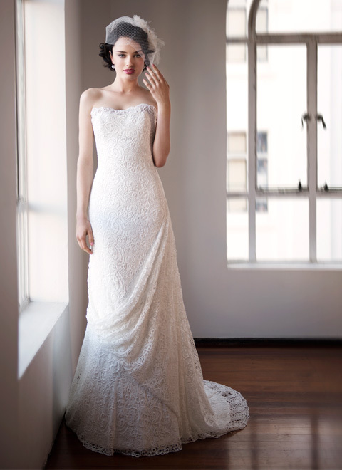 photo of beautiful crochet wedding gown with draping