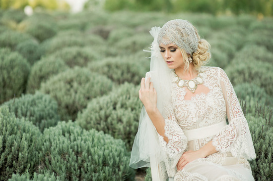 romantic bohemian bride wears sleeved crocheted wedding dress