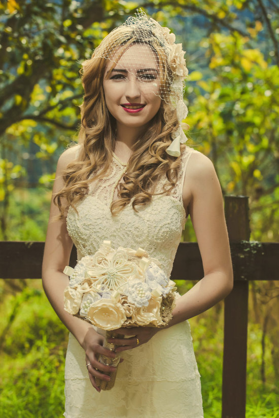 cream crochet wedding dress with high neckline