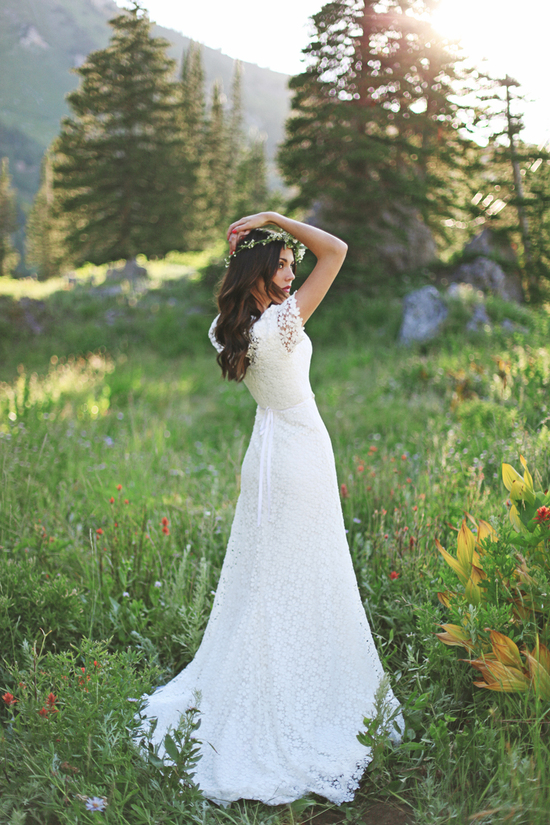 Romantic white crochet wedding dress with sheer sleeves and sash