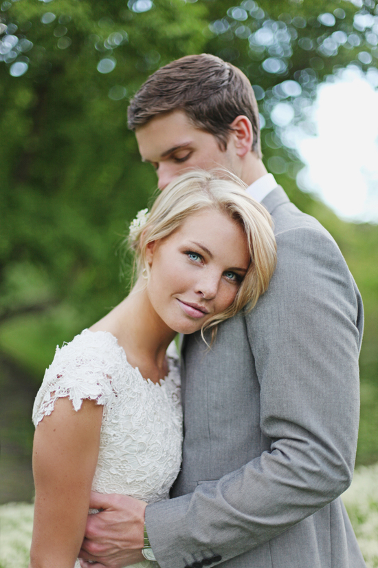 Beautiful blue eyed bride with soft wedding updo