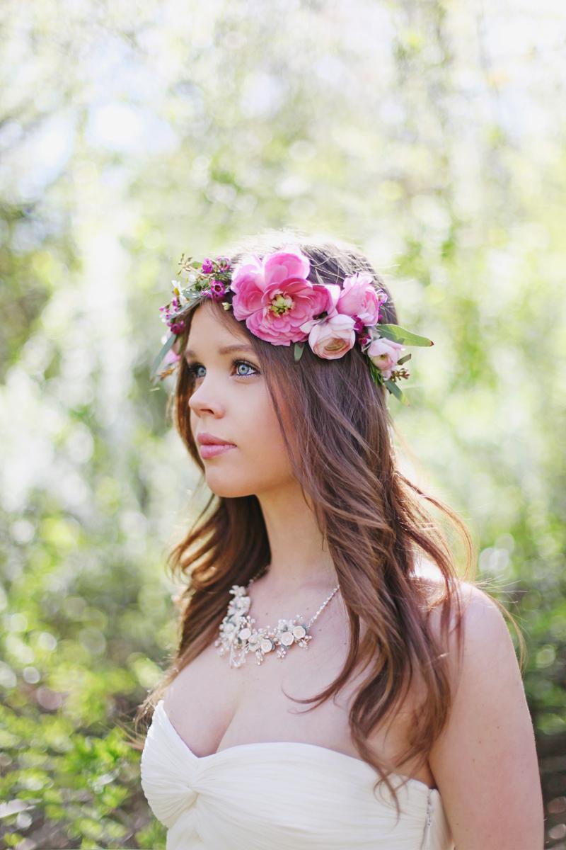 Bohemian-bride-wears-pink-floral-hair-wreath.full
