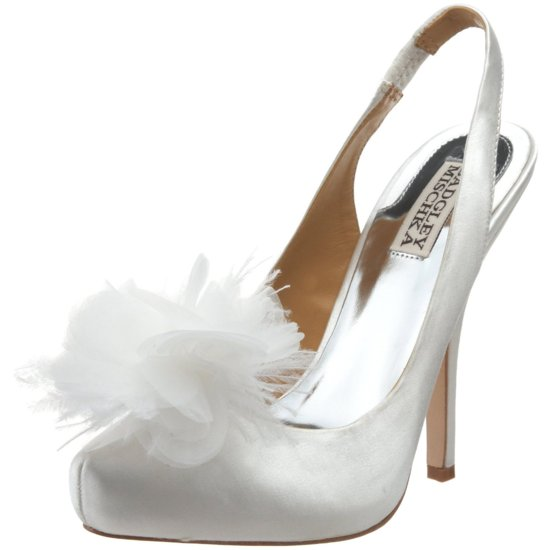photo of Luxe gold satin peep-toe wedding shoes with vintage-inspired brooch