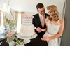 Bride-and-groom-cut-wedding-cake.square