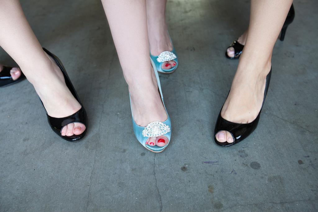 Bride-wears-blue-peep-toe-wedding-shoes-bridesmaids-in-black.full