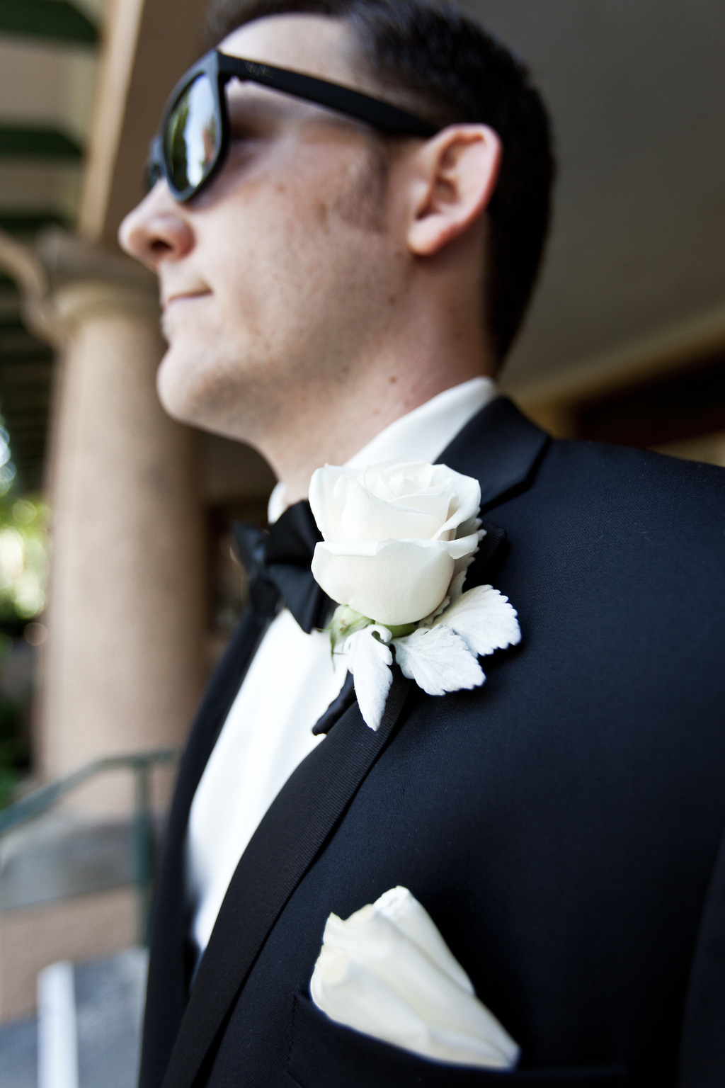 Classic-black-tie-groom-wearing-ray-bans.full