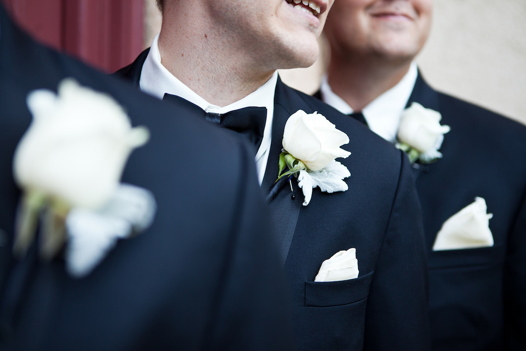 Classic-dapper-groom-and-groomsmen-showing-off-boutonnieres.full