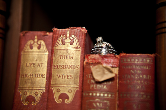 Engagement ring and wedding bands photographed on vintage books