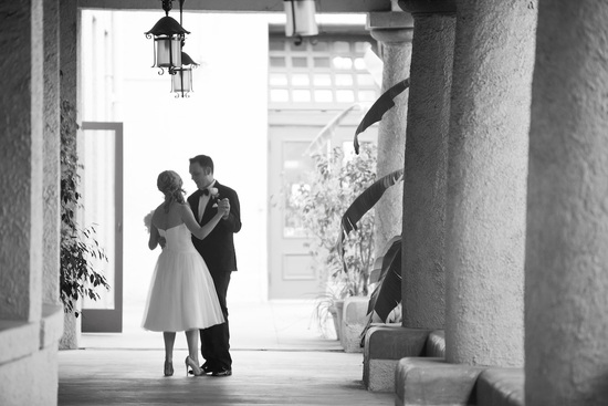 Bride and groom kiss outside mediterranean venue