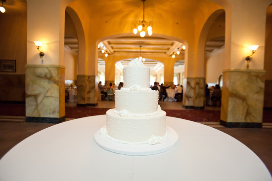 Classic white wedding cake with three tiers and dotted design