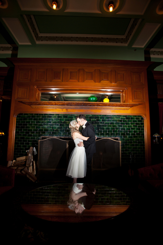 Bride and groom share an intimate kiss during the reception