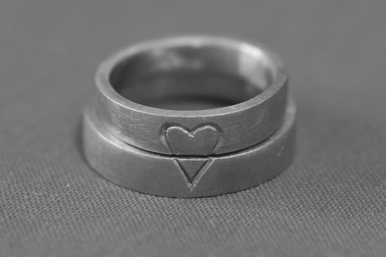 His and hers heart carved wedding rings