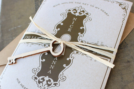 elegant gold and white wedding invites with heart shaped skeleton key