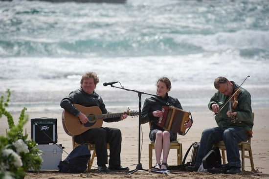 photo of 3-piece orchestra for beach wedding ceremony