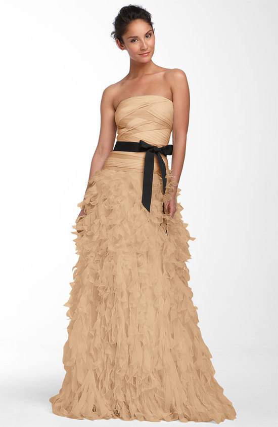 Butterscotch strapless wedding dress with embellished skirt and black bridal sash