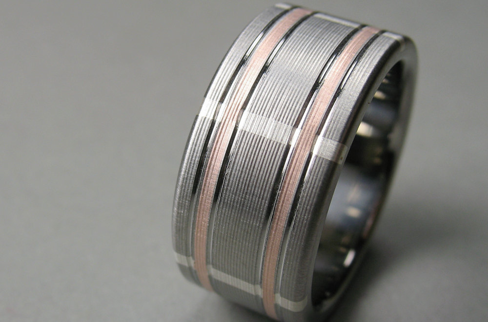 Rose-gold-and-silver-grooms-wedding-band.full
