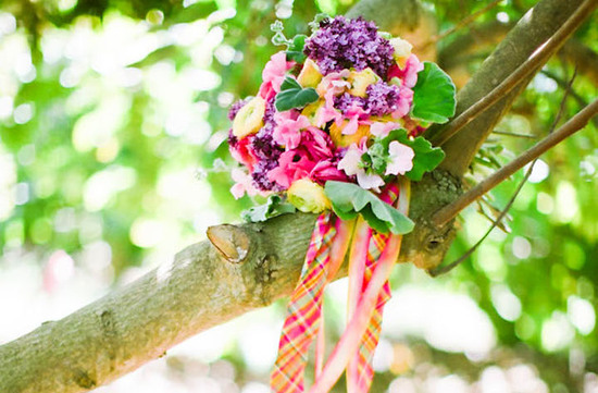 bright wedding bouquet with pink orange and green plaid ribbon