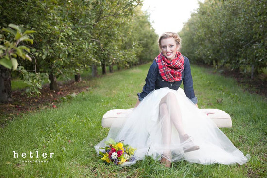 fall bride wears plaid scarf and jean jacket