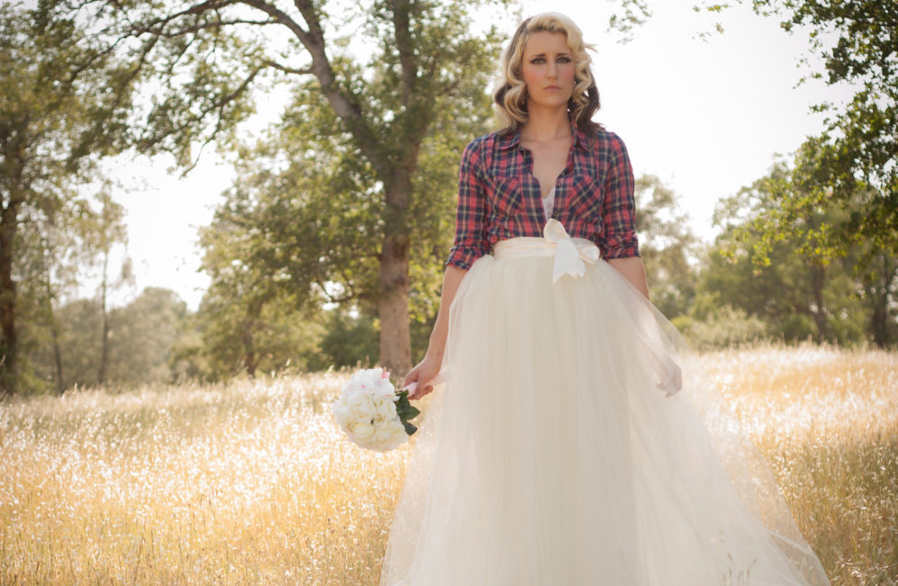 rustic wedding style with tulle skirt and plaid shirt
