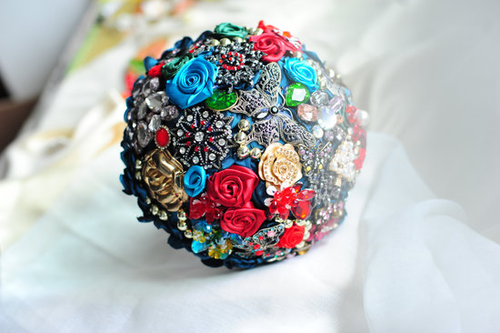 photo of brooch and fabric flowers wedding bouquet
