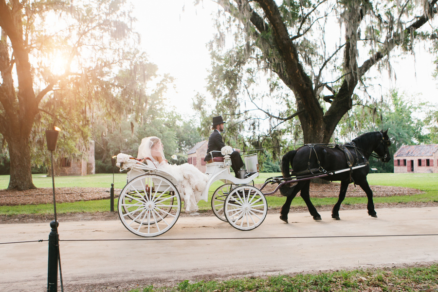Bride-arrives-to-wedding-ceremony-in-horse-drawn-carriage.full