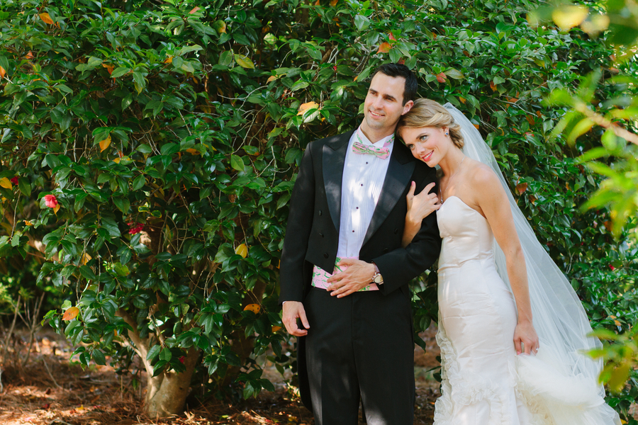 Romantic Bride And Groom Pose Outside Their Wedding Venue