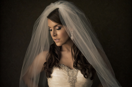 bride wears layered tulle veil with drop earrings