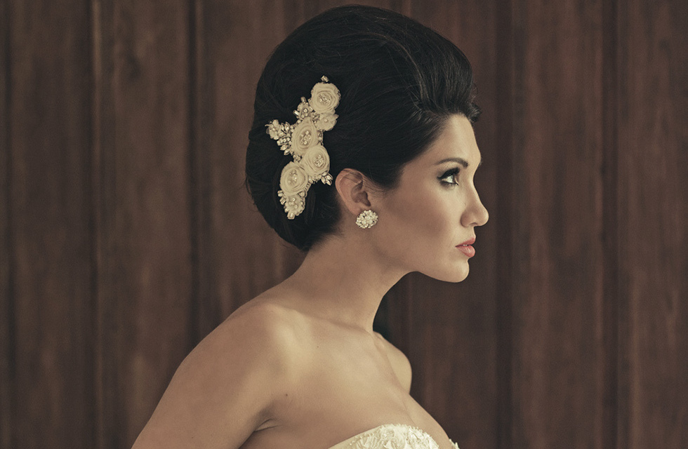 Haute-couture-bridal-updo-finished-with-an-embellished-clip.full