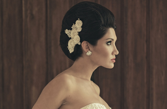 haute couture bridal updo finished with an embellished clip