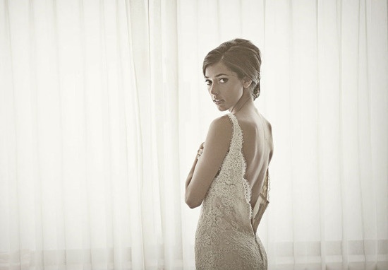 bridal portrait featuring low back lace wedding dress