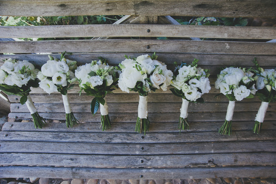 Real Wedding by Nat McComas Photography ivory and green bouquets in a row